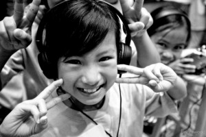 asian kid with headphones